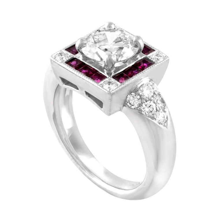 Art Deco Revival Ring The ring is Platinum 950 The center store 1.48 Carats L VS1 The center stone is GIA certified There are 0.70 Carats in Small Diamonds E/F VVS There are 0.60 Carats in Ruby The ring is a size 5.75, sizable The ring weighs 11.1