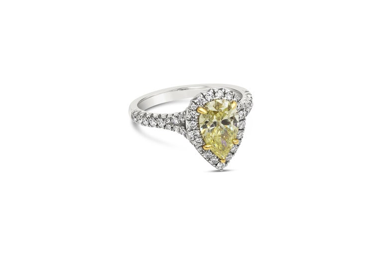 A color-rich engagement ring showcasing a 1.49 carat pear shape yellow diamond certified by GIA as Fancy Intense Yellow Color, SI2 clarity. Center diamond is surrounded by a row of round brilliant diamonds, set in a subtle split shank setting