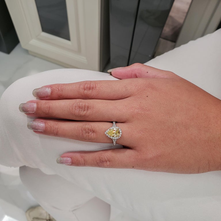 Contemporary GIA Certified 1.49 Carat Intense Yellow Diamond Halo Engagement Ring For Sale
