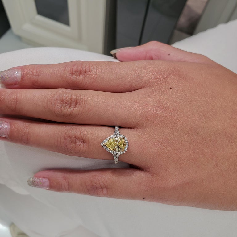 Pear Cut GIA Certified 1.49 Carat Intense Yellow Diamond Halo Engagement Ring For Sale