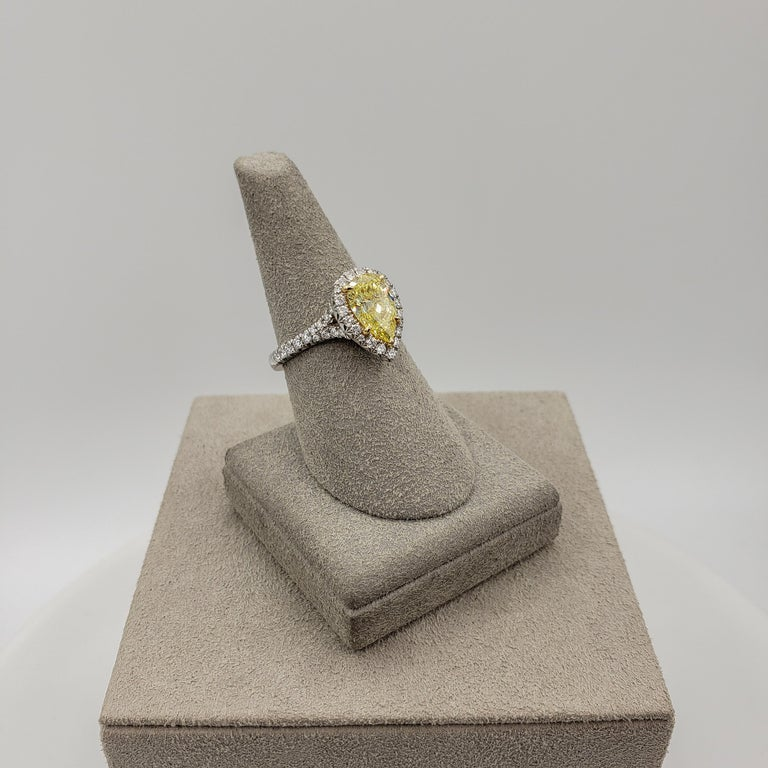 Women's GIA Certified 1.49 Carat Intense Yellow Diamond Halo Engagement Ring For Sale
