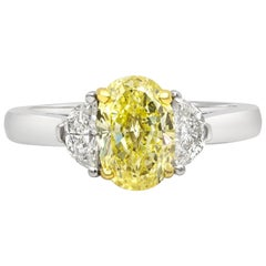 GIA Certified 1.50 Carat Intense Yellow Oval Diamond Three-Stone Engagement Ring