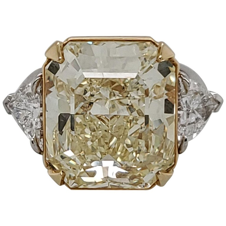 GIA Certified 15.07 Fancy Yellow VS1 Center Diamond Stone 3-Stone Ring For Sale
