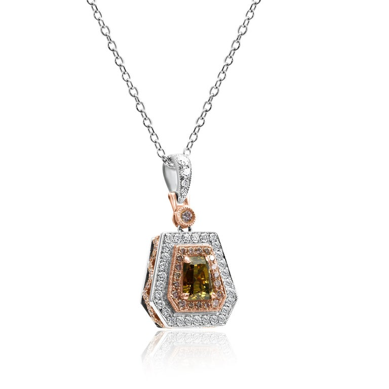 Rare GIA Certified 1.53 Carat Natural Fancy Deep Brownish Orangy Yellow Shield Cut Diamond Encircled in Double Halo of 64 Natural Fancy Pink Diamond SI Clarity 0.61 Carat and 33 White Colorless VS-SI Clarity Diamond Rounds 0.49 Carat in Gorgeous 18K