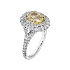 GIA Certified 1.51 Carat Oval Fancy Yellow Diamond Engagement Ring