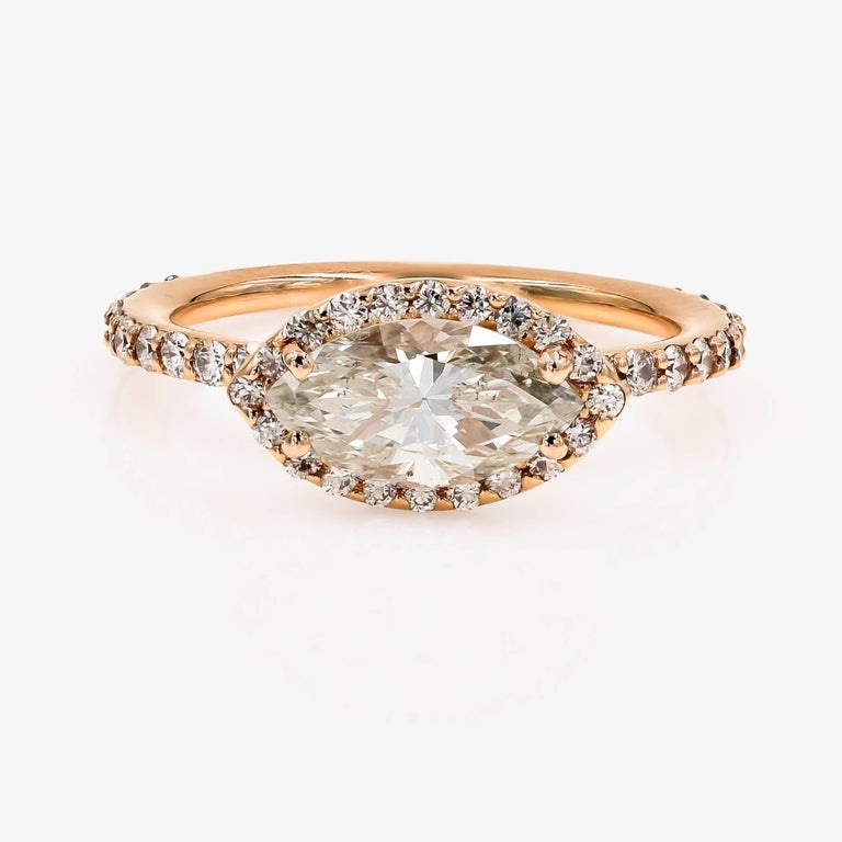This Lester Lampert D-Bead style setting in 18kt. rose gold, contains a 1.51cts. Marquise center that is K color and SI2 clarity. Surrounding the center and down the shank are 44 ideal cut round diamonds=.59ct. t.w.  This pieces comes with GIA