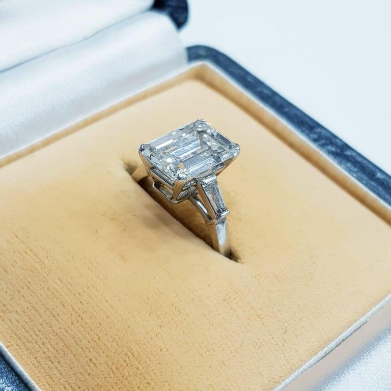 Modern IGI Certified 3 Emerald Cut Solitaire Engagement Ring Platinum For Sale