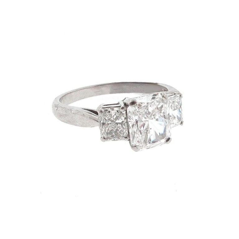 Modern GIA Certified, 1.53 carat E-Si1 Radiant Diamond Three-Stone Engagement Ring