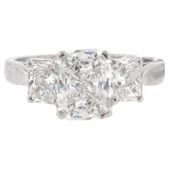 GIA Certified, 1.53 carat E-Si1 Radiant Diamond Three-Stone Engagement Ring