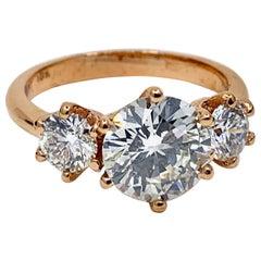 GIA Certified 1.55 Carat Diamond in Rose Gold Three-Stone Setting