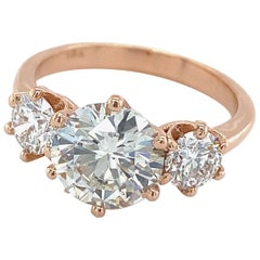GIA Certified 1.55 Carat Diamond in Rose Gold Three-Stone Setting