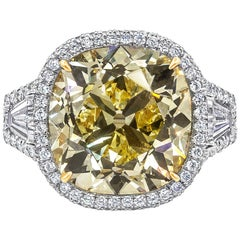 GIA Certified 15.52 Carat Yellow Diamond Three-Stone Halo Ring