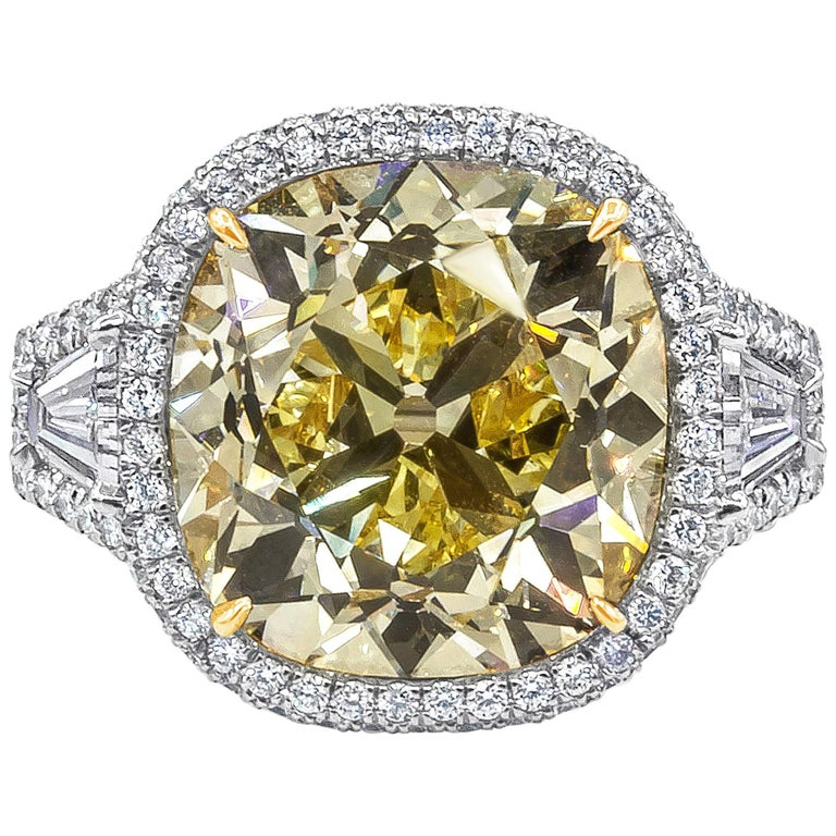 GIA Certified 15.52 Carat Yellow Diamond Three-Stone Halo Ring For Sale