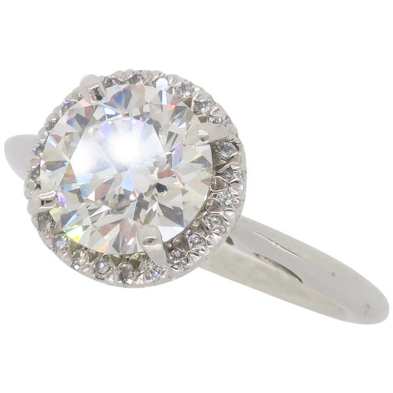 GIA Certified 1.52 Carat VVS1 Diamond Halo Engagement Ring For Sale