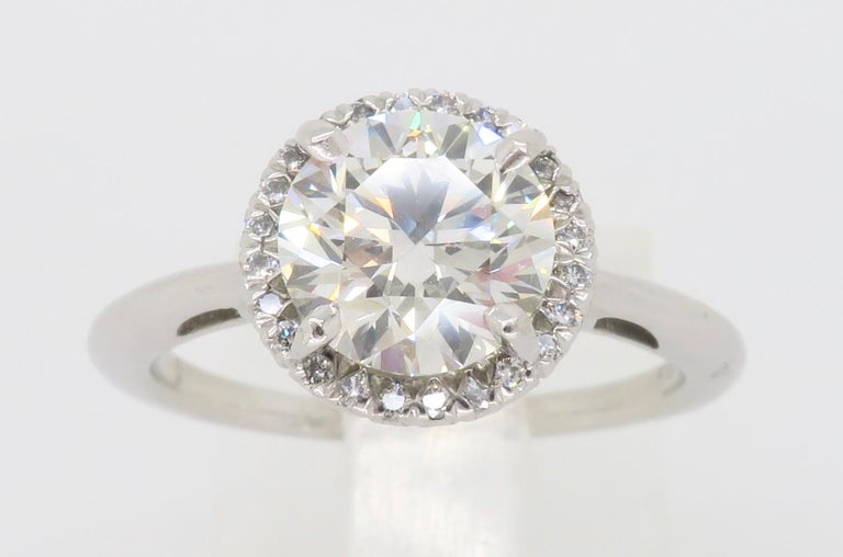 Round Cut GIA Certified 1.52 Carat VVS1 Diamond Halo Engagement Ring For Sale