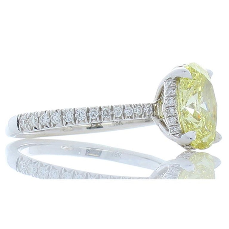 Contemporary GIA Certified 1.63 Carat Oval Fancy Yellow Diamond White Gold Cocktail Ring