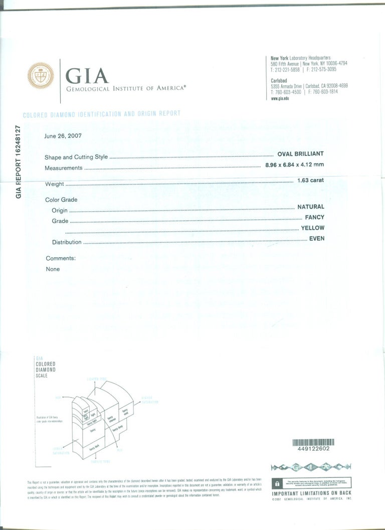 Oval Cut GIA Certified 1.63 Carat Oval Fancy Yellow Diamond White Gold Cocktail Ring