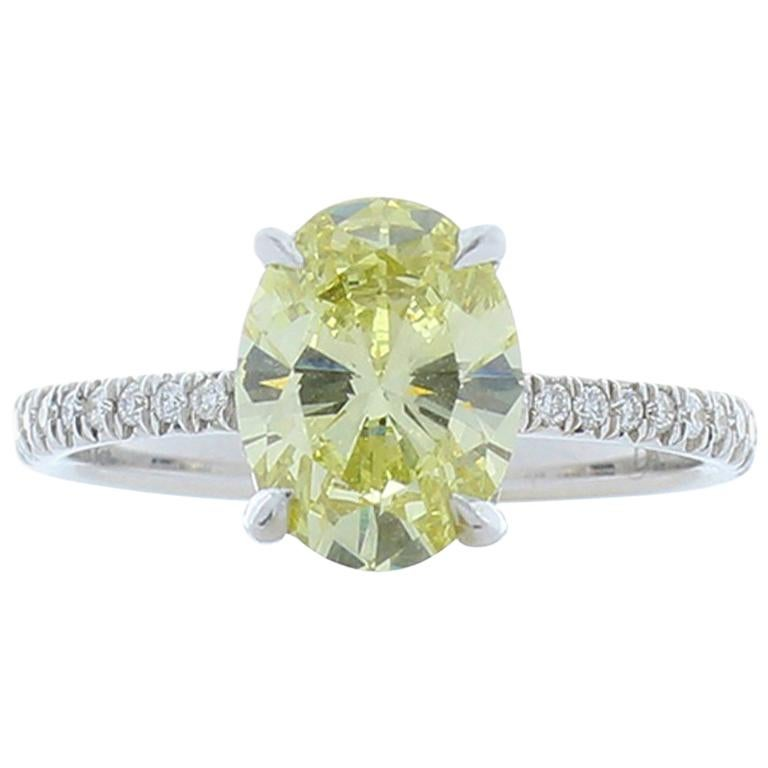 GIA Certified 1.63 Carat Oval Fancy Yellow Diamond White Gold Cocktail Ring