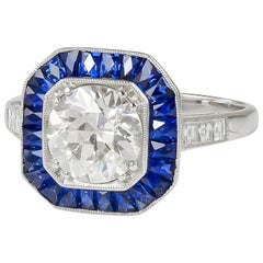 GIA Certified 1.66 Carat Round Cut Center Diamond and Sapphire Ring