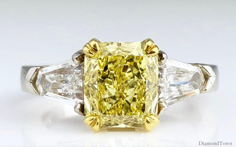 Contemporary GIA Certified 1.68 Carat Natural Fancy Intense Yellow Diamond Ring in Platinum For Sale