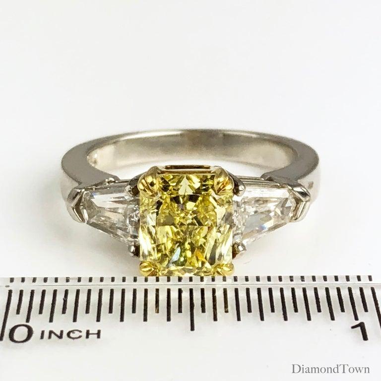 Women's GIA Certified 1.68 Carat Natural Fancy Intense Yellow Diamond Ring in Platinum For Sale