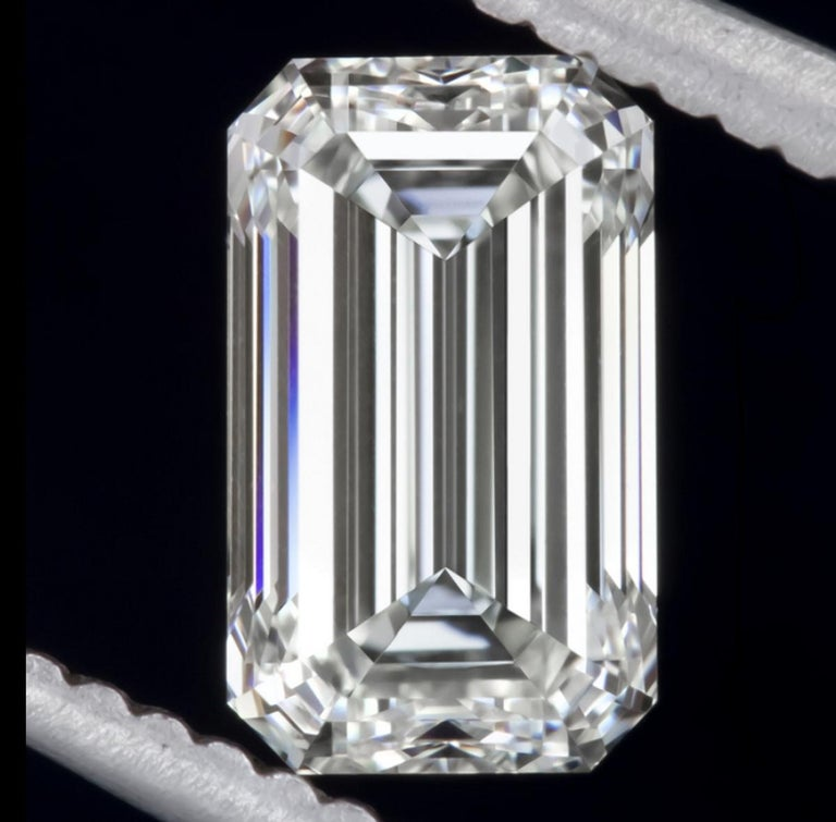 Modern GIA Certified 1.75 Carat Diamond Long Emerald Cut Natural Diamond Ring For Sale