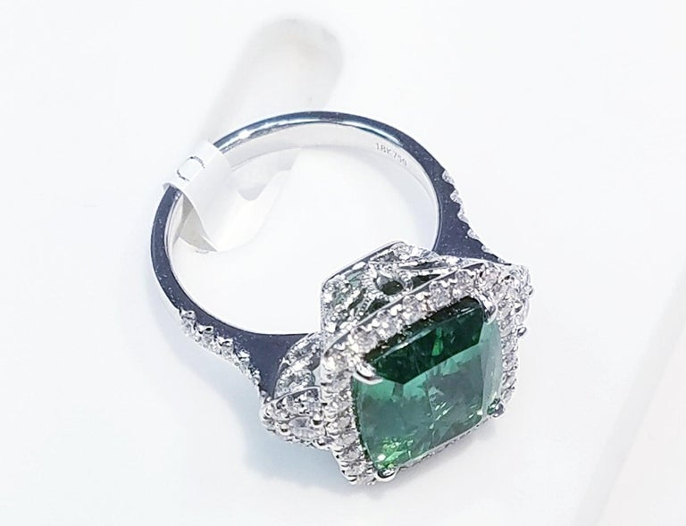 GIA Certified 18k Wt. Gold Cushion Cut Blue-Green Tourmaline and Diamond Ring 7.74 Carats of Blue-Green Tourmalines 0.73 Carats of Natural Diamonds 18 Karat White Gold Antique Cushion Cut  GIA Certified