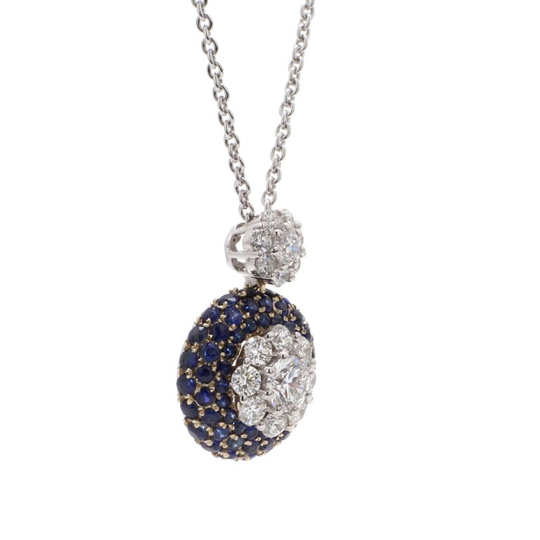 A Beautiful Handcrafted Necklace in 18 karat White Gold with Natural Brilliant Cut Colorless GIA Certified Round Diamond And AAA Cut Round Blue Sapphire Gemstones. A Statement piece for Daily Wear totaling 0.98 ct of Diamonds & 0.01 Carat of Natural