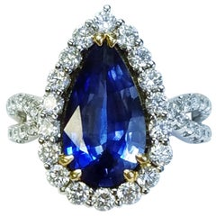 GIA Certified 18 Karat White Gold Pear Cut Blue Sapphire and Diamond Ring