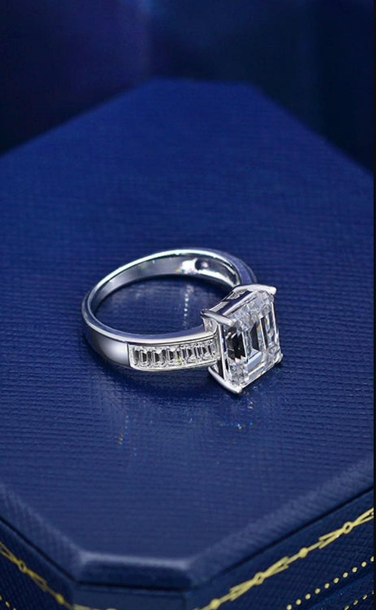 This ring exudes class ans sophistication the main stone has the perfect proportions and ratio.