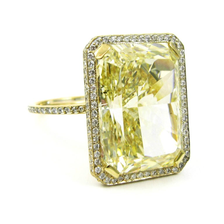 GIA Certified 18.13 Carat Fancy Yellow Radiant Cut Diamond Yellow Gold Pave Ring In Excellent Condition For Sale In New York, NY