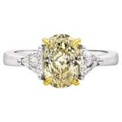 GIA Certified 1.87 Carat Oval Yellow Diamond Three-Stone Engagement Ring