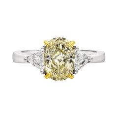 GIA Certified 1.87 Carat Oval Yellow Diamond Three-Stone Engagement Ring