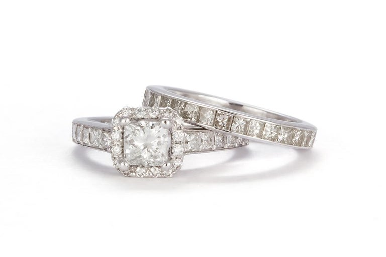 We are pleased to offer this GIA Certified 18k White Gold & Princess Diamond Halo Wedding Set 3.58ctw. This beautiful wedding set features an 18k white gold halo engagement ring set with a GIA certified & laser inscribed 0.60ct G/VS2 princess cut