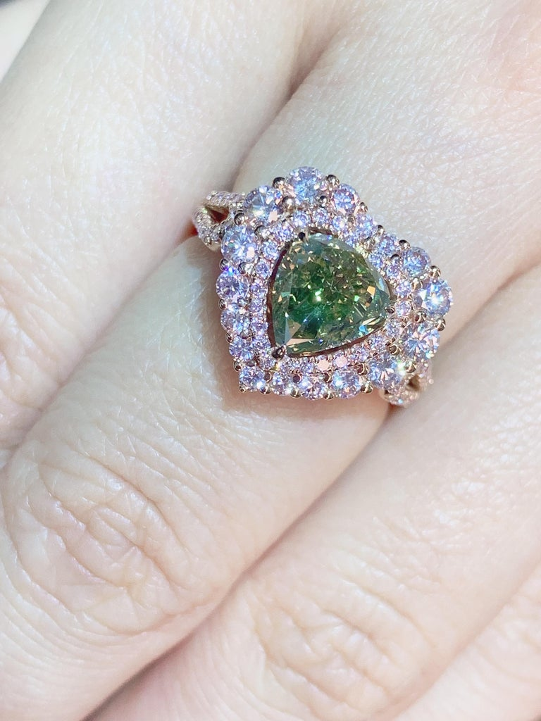 Classic designed ring featuring a  2.01 carat heart shape Fancy Brown Greenish Yellow Diamond with light pink diamond finished in pink gold.   center stone : 2.01ct  side stone : fancy diamond 1.47ct/ 110pcs  Comes in a Kahn ring box, with ORIGINAL
