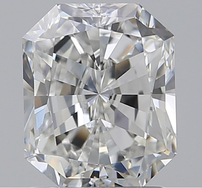 The main stone weights 1.60 carats and is actually quite large  7.31x5.99 mm G Color VS Clarity  Triple Excellent Cut and Polish None Fluorescence