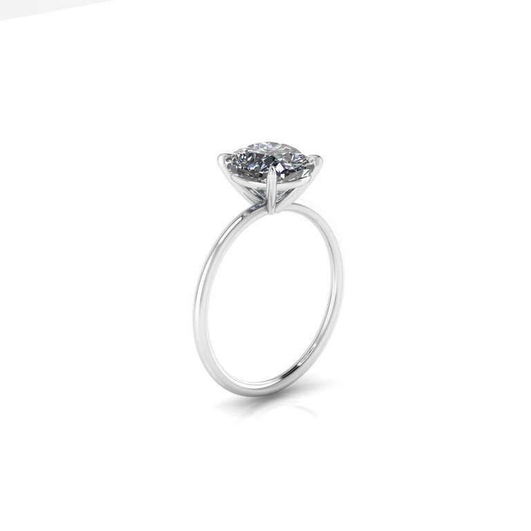 GIA Certified 2.01 carat Cushion diamond, H color,  SI2 clarity,  set in low setting, thin and delicate engagement ring made in Platinum 950  The ring size is a 6