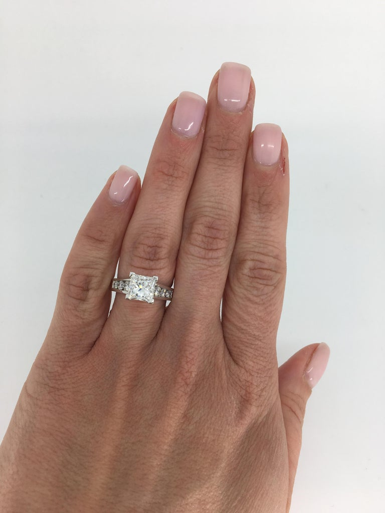 This classic engagement ring features a GIA Certified 2.01CT Princess Cut Diamond with 6 round brilliant cut diamonds accenting it.  GIA Certified, Electronic Copy Only, and GIA verification report Diamond is laser Scribed- GIA 12323650   Center