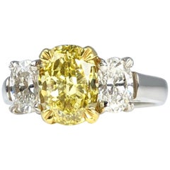 GIA Certified 2.01 Carat Natural Fancy Intense Yellow Diamond Ring in Platinum