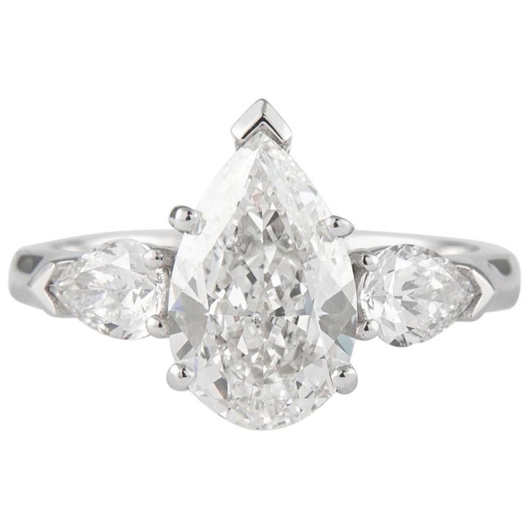 GIA Certified 2.01 Carat Pear Cut Diamond Three-Stone Ring Platinum For Sale