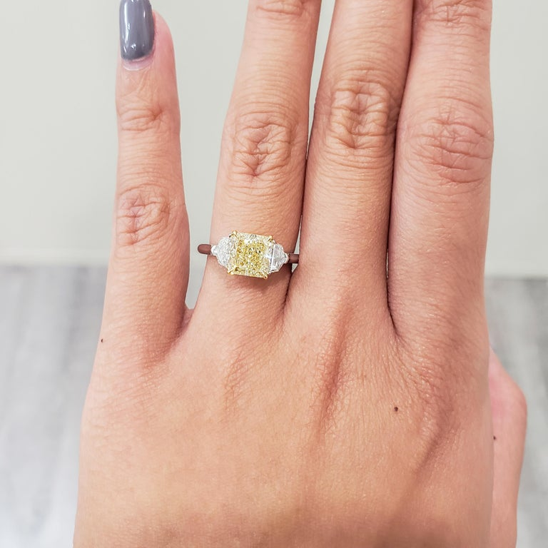 Radiant Cut GIA Certified 2.01 Carat Yellow Diamond Three-Stone Engagement Ring For Sale