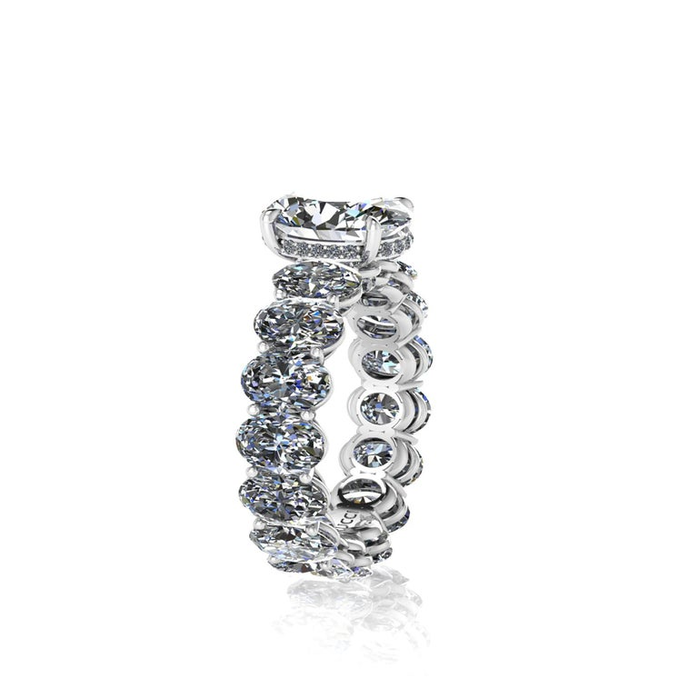 GIA Certified 2.01 Carat Oval diamond, F color, VS1 clarity, Triple Excellent Cut, Symmetry and Polish, set on a Platinum 950, Oval diamond eternity ring, designed and hand made in New York with the gem adorned by pave of white round diamonds, for a