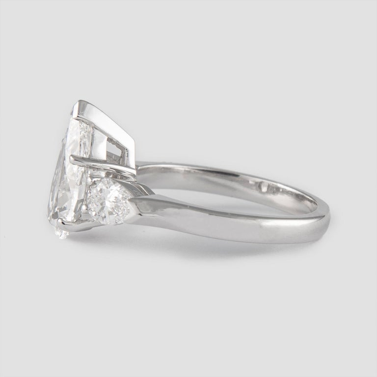 Modern GIA Certified 2.01 Carat Pear Cut Diamond Three-Stone Ring Platinum For Sale