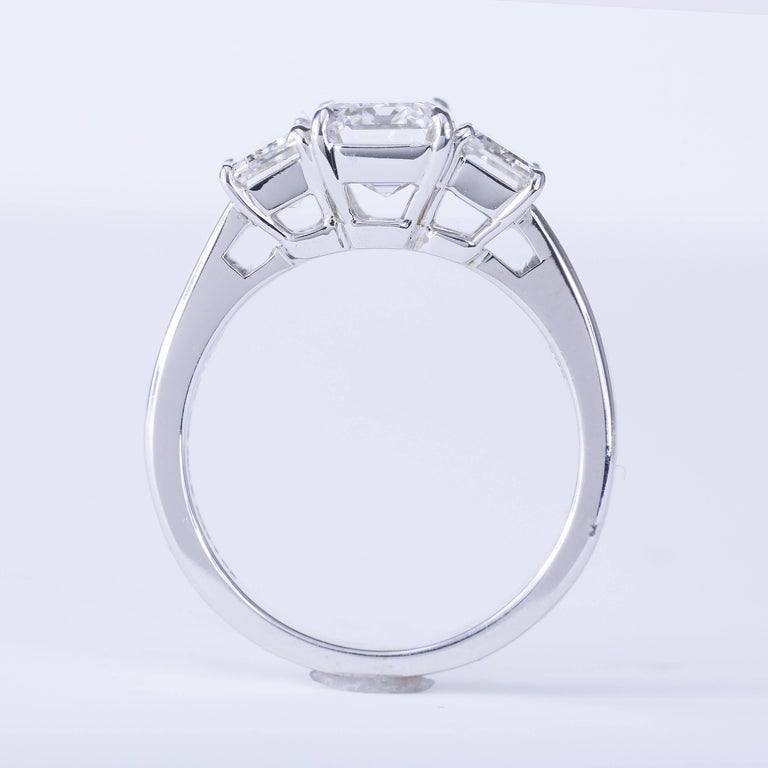 GIA Certified 2.02 Carat G VS2 Emerald Cut Three-Stone Ring 18 karat White Gold In New Condition For Sale In Chicago, IL