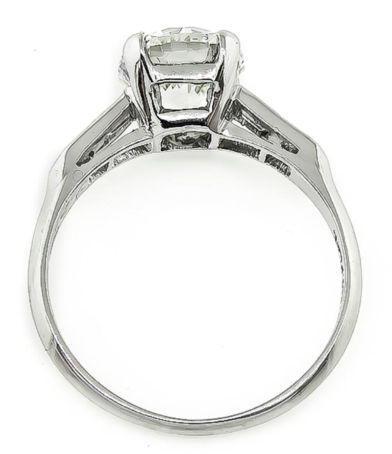 This amazing platinum engagement ring is centered with a sparkling GIA certified round brilliant cut diamond that weighs 2.03ct. graded L color with VS1 clarity. The center diamond is accentuated by dazzling baguette and round cut diamond accents.