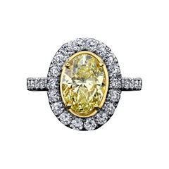GIA Certified 2.05 Carats Oval Yellow Diamond Ring