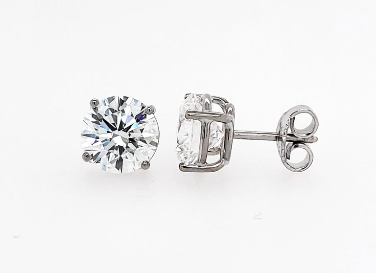 Beautiful stud earrings featuring 2.09 & 2.16 carat round diamonds. The diamonds are GIA certified stating that they are of D color, VS2 clarity.  Total carat weight is 4.25. 18k White Gold is 3.59 grams.