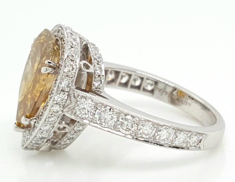 GIA Certified 2.12 Carat Fancy Yellow Pear Diamond Ring For Sale 4