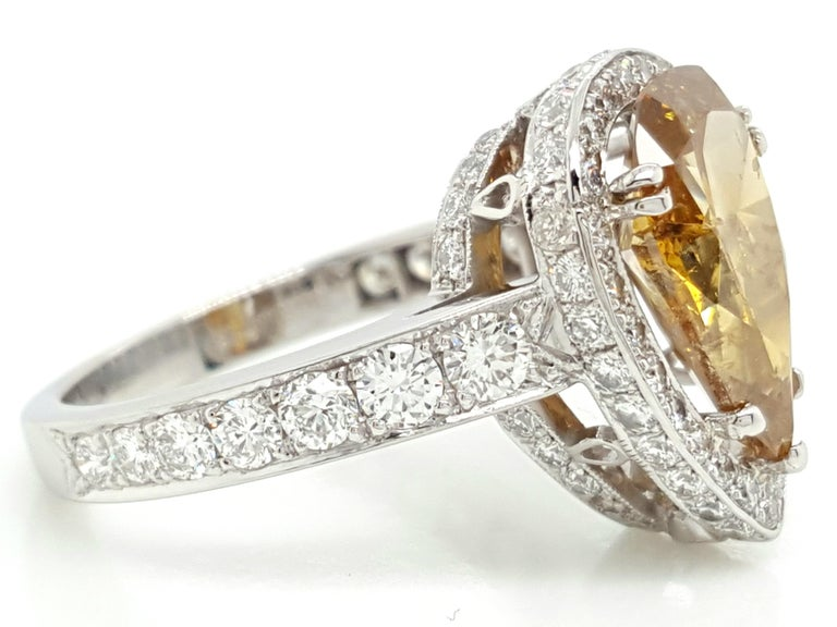 Contemporary GIA Certified 2.12 Carat Fancy Yellow Pear Diamond Ring For Sale