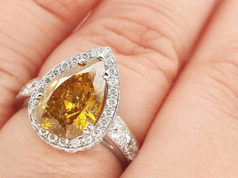 Pear Cut GIA Certified 2.12 Carat Fancy Yellow Pear Diamond Ring For Sale